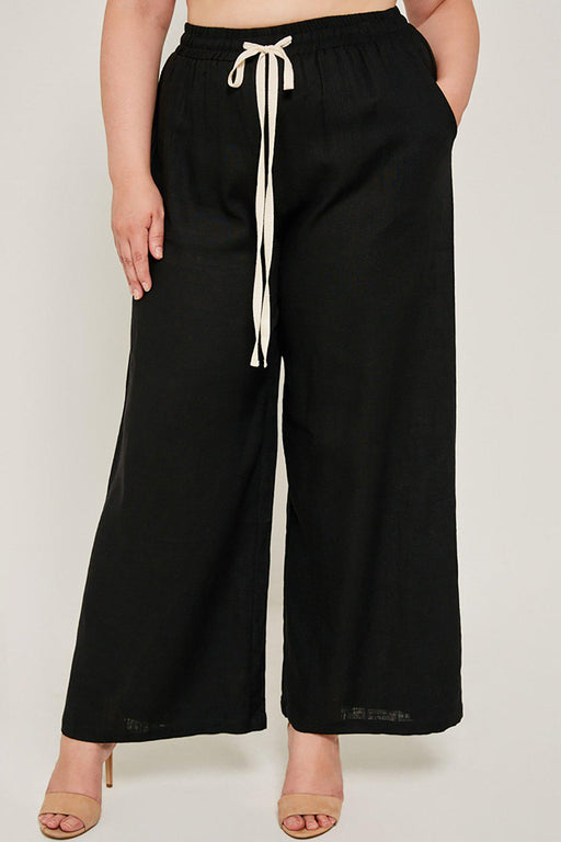 Plus-size wide leg black Madison pant close-up front view on model