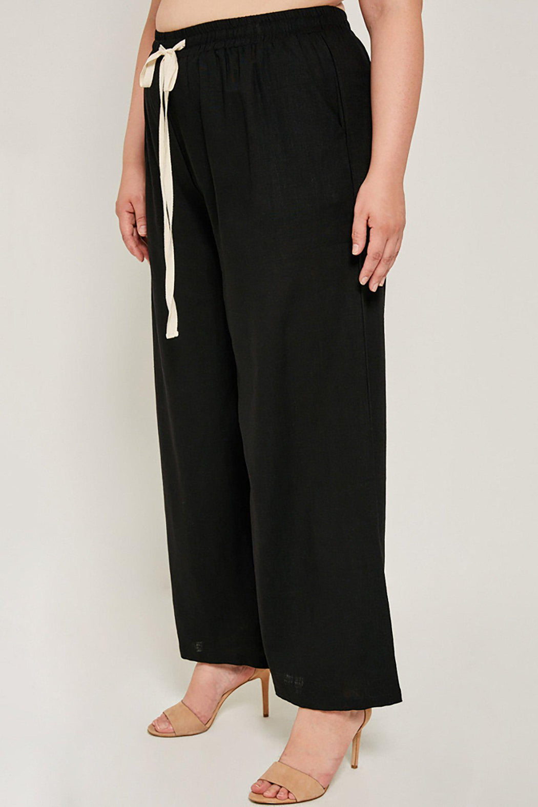 Plus-size wide leg black Madison pant close-up side view on model