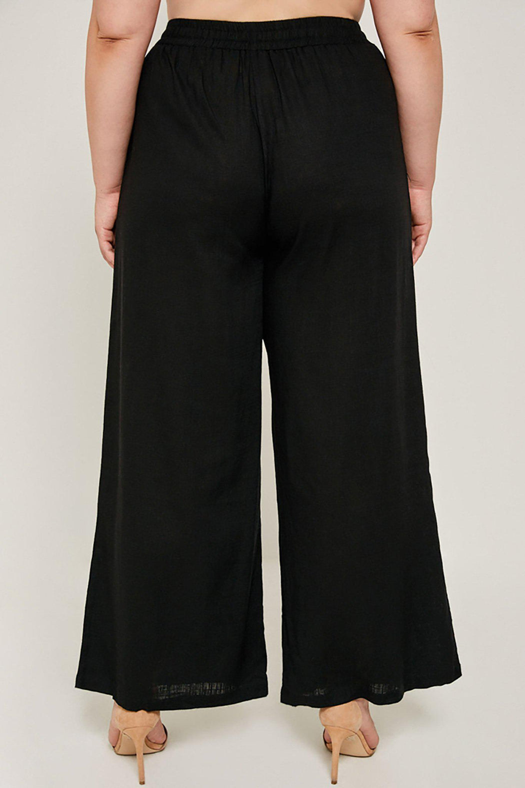 Plus-size wide leg black Madison pant close-up back view on model