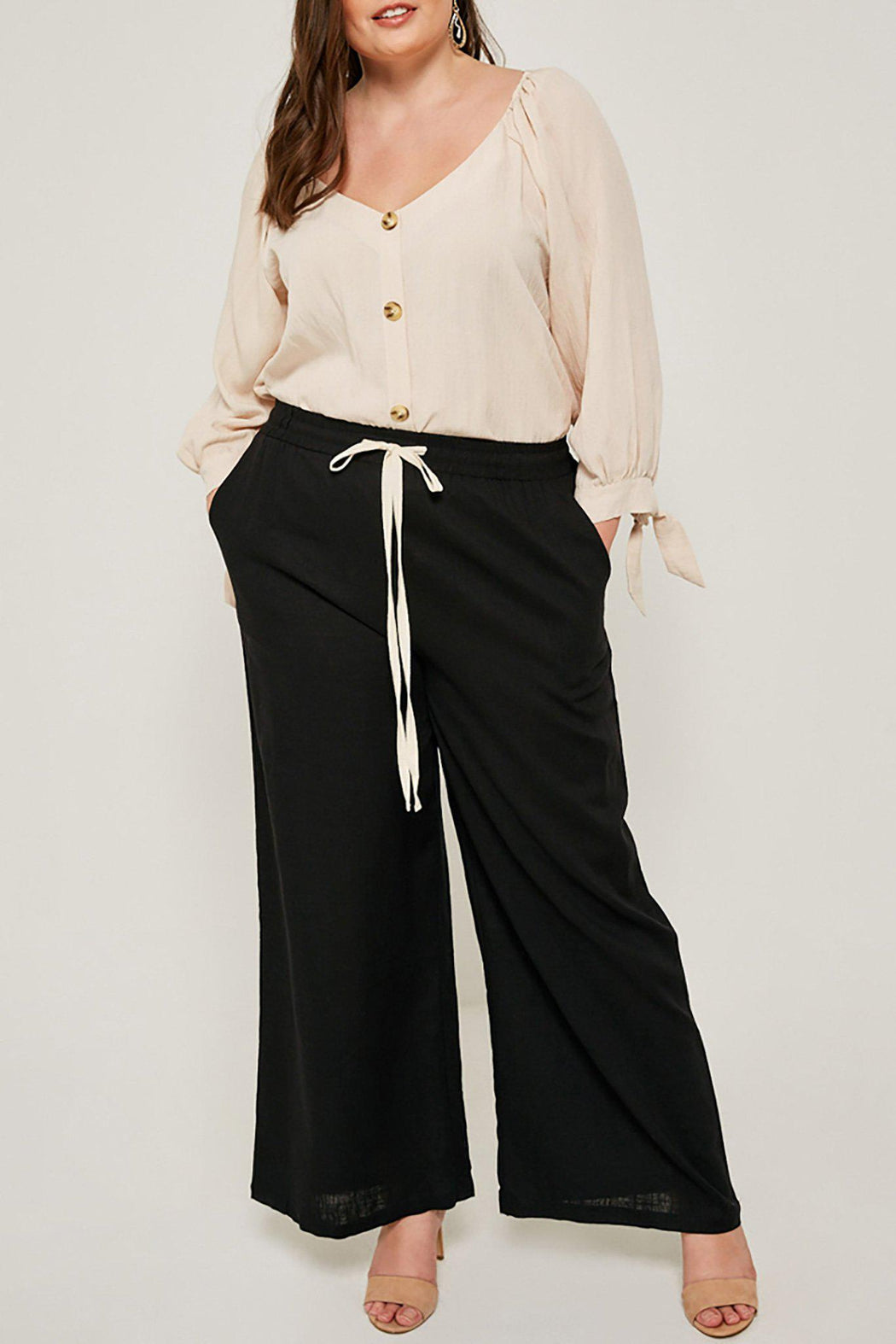 Plus-size wide leg black Madison pant full outfit view on model