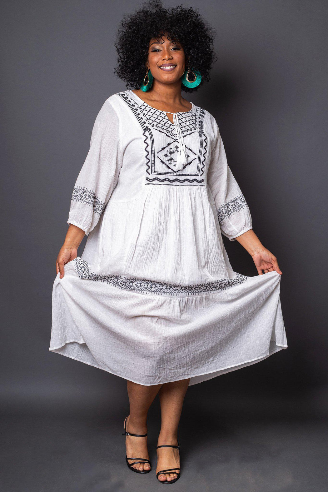 Salma Embroidered Maxi Dress front view on model holding dress at sides
