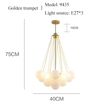 balloon bouquet golden body and frosted glass chandelier