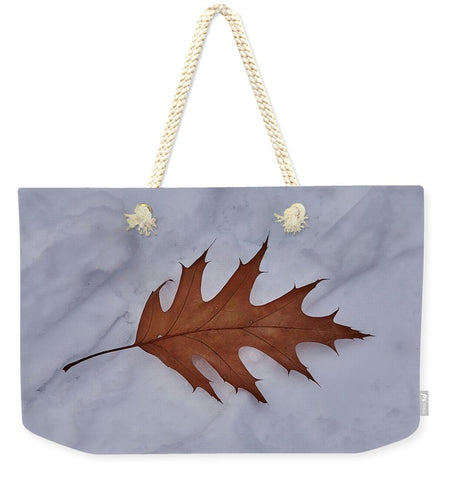 Image of Leaf On The Snow - Weekender Tote Bag - 24 X 16 / Natural - Weekender Tote Bag
