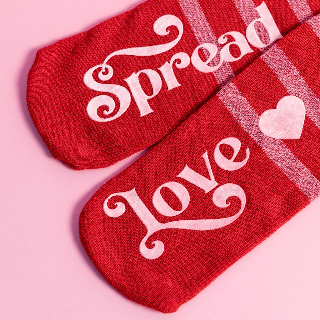 One-size-fits-all socks. 80% Cotton, 15% Polyester, 5% Spandex.