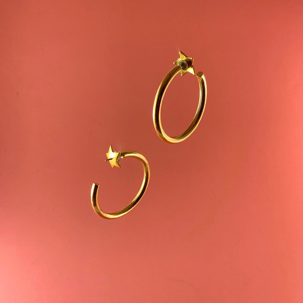 Gold plated hoop earrings. Star backing makes the hoop earring interchangeable. Handmade in India by Latina clothing brand GRL Collective.
