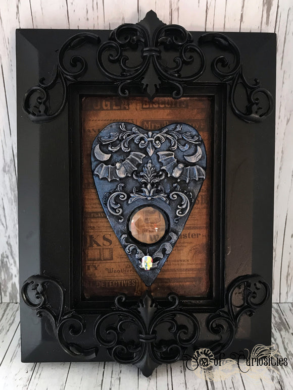 Blue Planchette in ornate frame