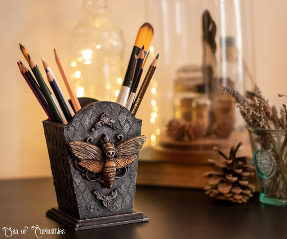 Gothic moth make-up brush, pencil and pen holder.