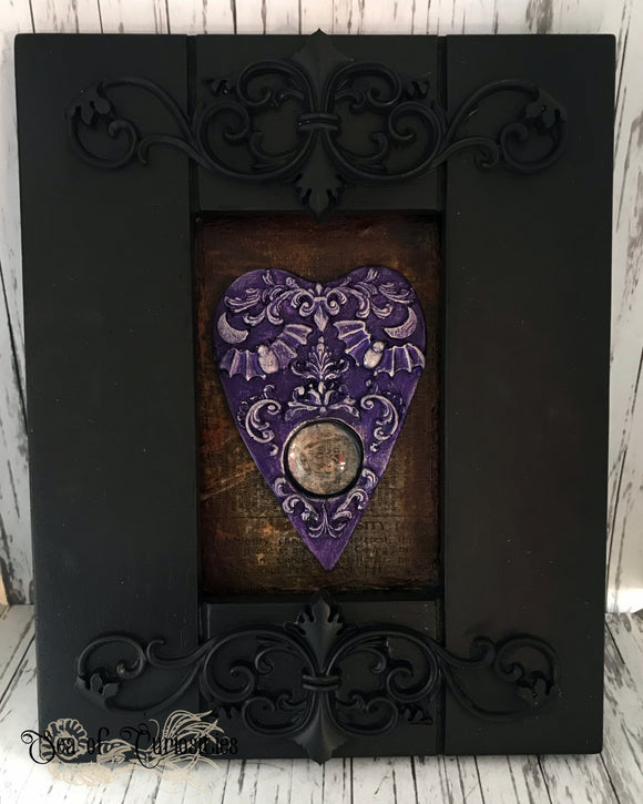 Purple Planchette in ornate frame