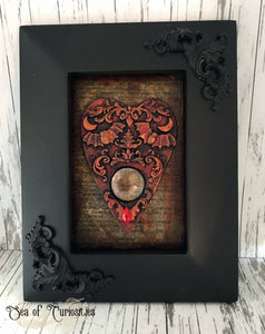 Red Planchette in ornate frame