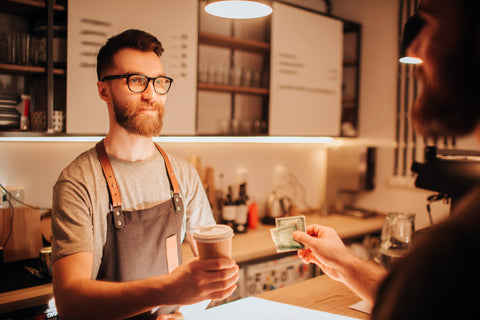 Barista and Customer, Why You Need a Website for Your Coffee Shop (and How to Make it)