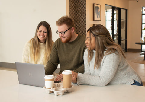 People on Computer with Coffee, Why You Need a Website for Your Coffee Shop (and How to Make it)