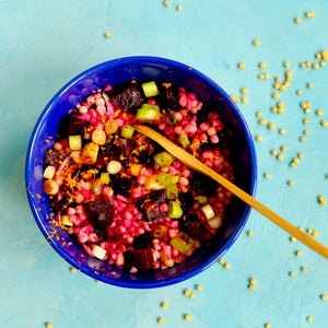 A Mediterranean couscous salad with a roasted beet and orange twist