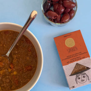 Bowl of lentil soup with olives and Sparoza's cooking blend with spices and orange zest