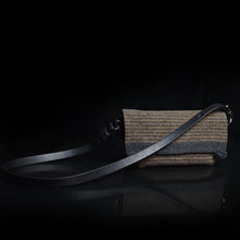 Compass Handbag in Earth Multistripe on black background.