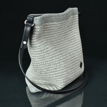 Explorer Handbag in natural cloud stripe. Three-quarter view