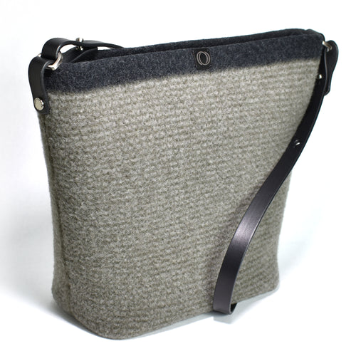 Knit-felted, ultra-fine merino wool handbag in Alpine Stripe. Vegetable tanned English bridle leather strap and trim with lacquer-finished, brushed nickel hardware.