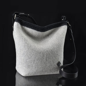 Pilot handbag in thickly felted merino wool. Color is snowdrift.