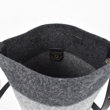 Knit-felted, ultra-fine merino wool handbag in Graphite. Vegetable tanned English bridle leather strap and trim with lacquer-finished, brushed nickel hardware.