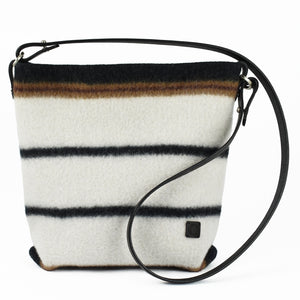 Knit-felted, ultra-fine merino wool handbag in Earth. Vegetable tanned English bridle leather strap and trim with lacquer-finished, brushed nickel hardware.