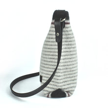 Side view of hand-knitted, boiled wool handbag in gray stripes on cream ground. Organic, renewable and toxin free.