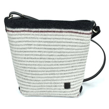 Hand knitted boiled wool handbag in black stripes on cream ground. Organic, renewable and toxin free.