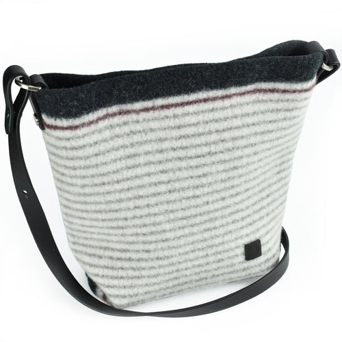 Hand-knit, boiled wool handbag in gray stripes on cream ground. Organic, renewable and toxin free.