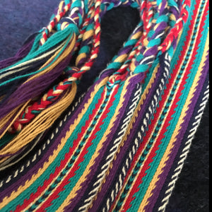 Colorful, tablet woven strap - southwest motif in turquioise,purple, gold and flame red. with colorful, braided, tassel ends.