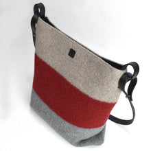 Knit-felted, ultra-fine merino wool handbag in Smoke, Flame and Cloud. Vegetable tanned English bridle leather strap and trim with lacquer-finished, brushed nickel hardware.