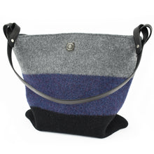 Knit-felted, ultra-fine merino wool handbag in Licorice, Night Sky and Ash. Vegetable tanned English bridle leather strap and trim with lacquer-finished, brushed nickel hardware.