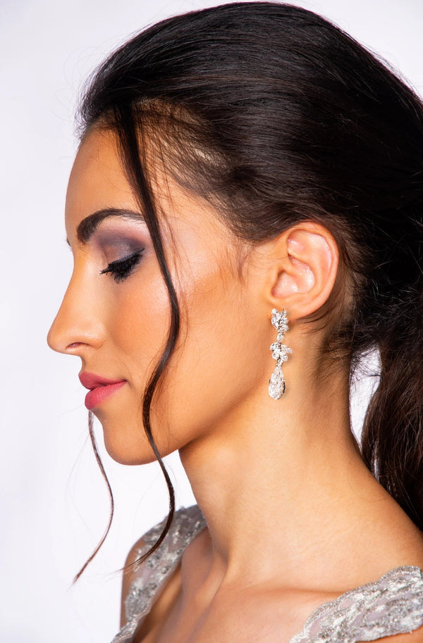 Woman with silver swarovski crystal rain drop earrings