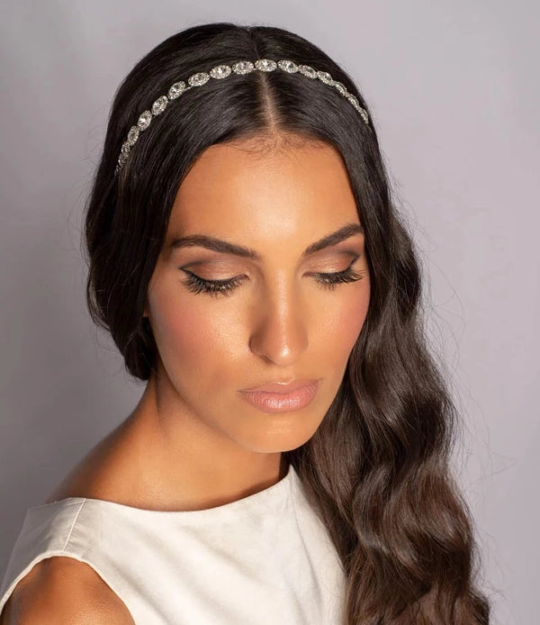 Woman wearing round crystals bridal tiara