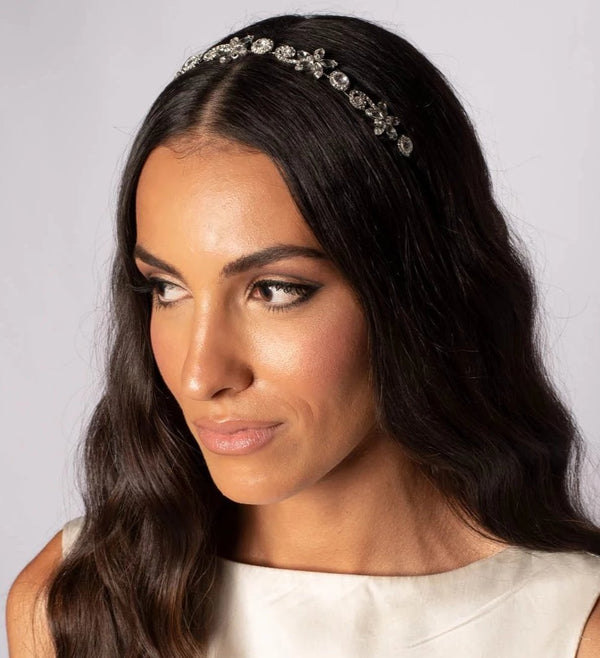 Woman with Flowers and swarovski crystals bridal hairband