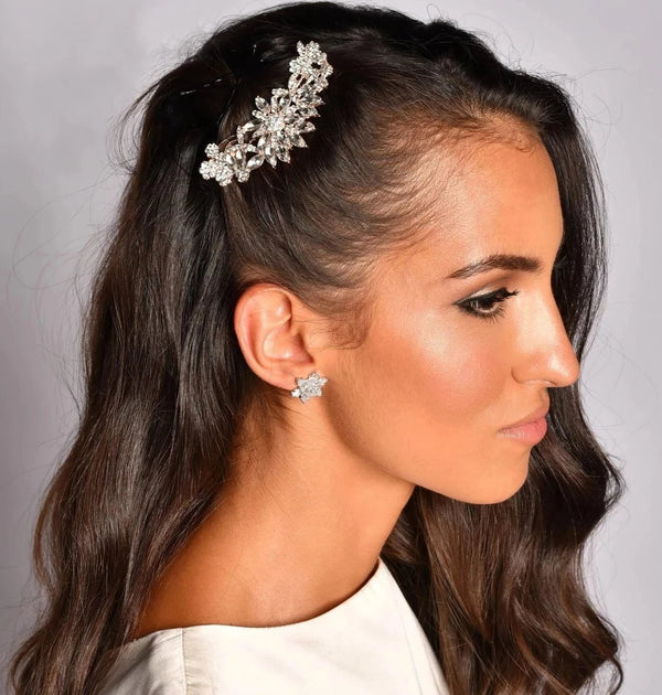 Woman with Rose gold floral crystal bridal hair comb on marble background