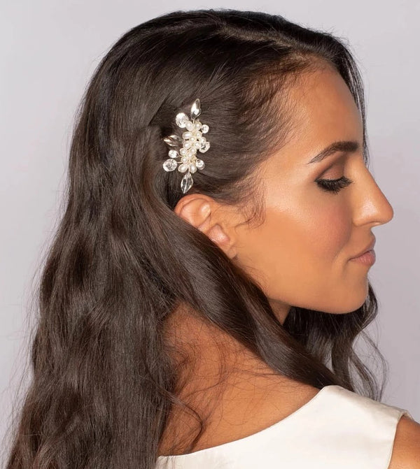 Woman with Crystals and pearls bridal hair comb on white background