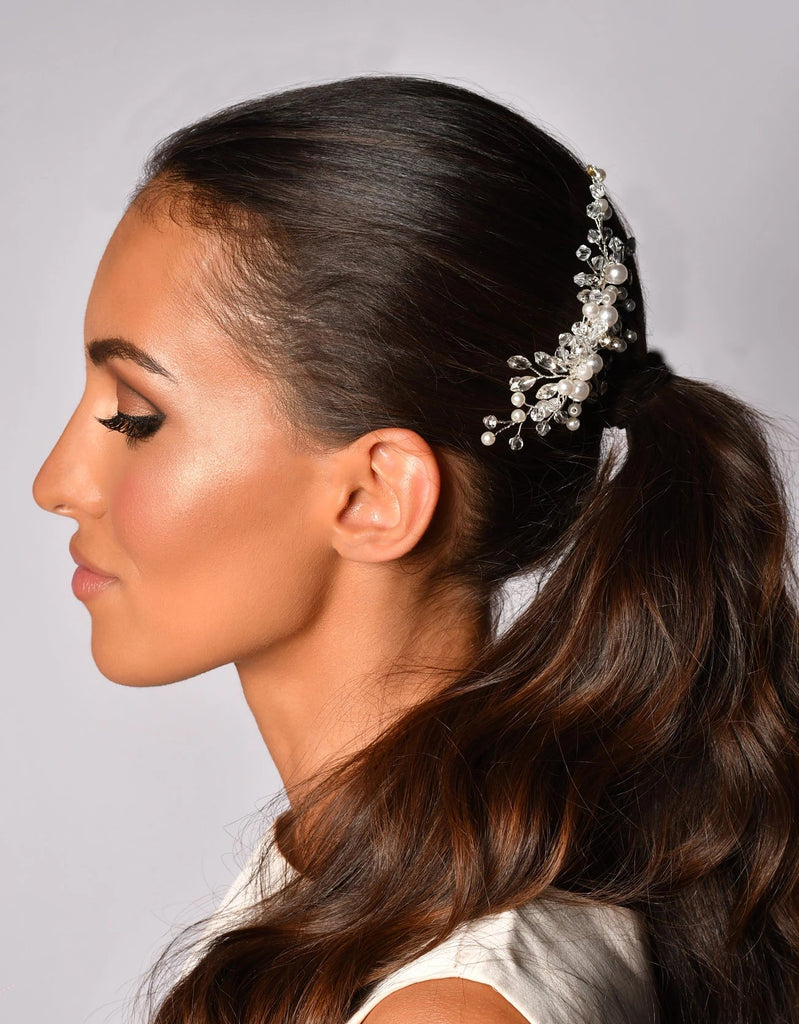 Woman with a Floral bridal hair comb with crystals and pearls on white background