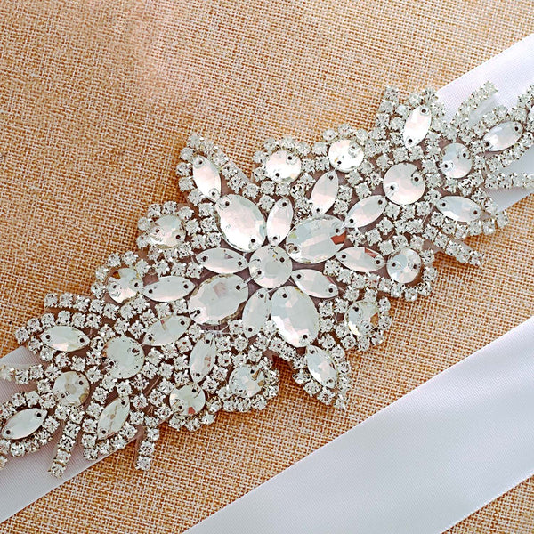 Bridal belt with crystals and rhinestones on a white ribbon