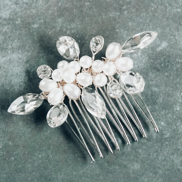 Crystals and pearls bridal hair comb on a gray background
