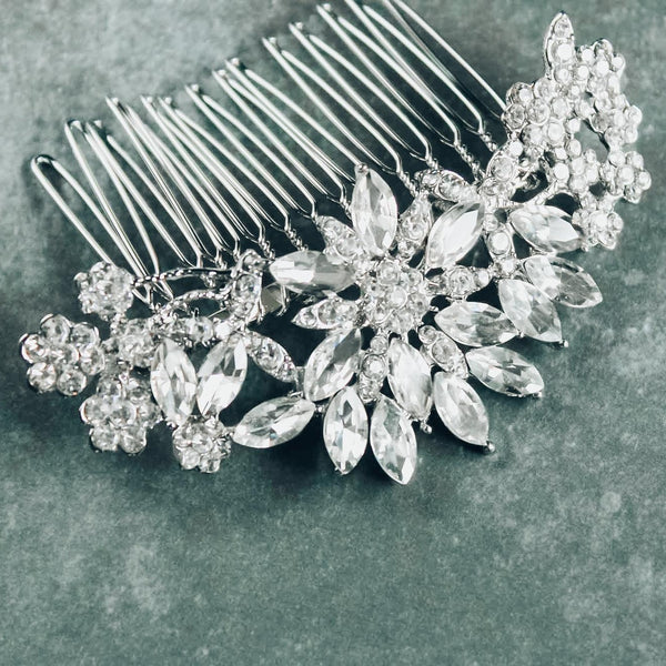 Silver floral crystal bridal hair comb on gray background