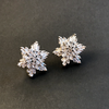 Flower shaped swarovski crystal marquee cut stud earrings on a black background