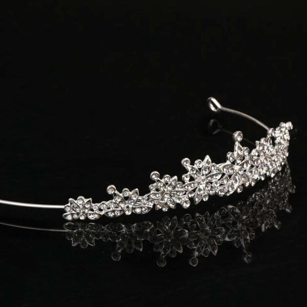 Bridal silver tiara with peaks of sparkling gemstones in a flowing floral pattern