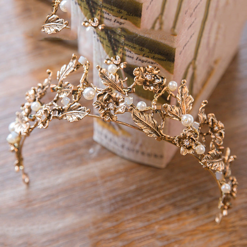 Gold tiara with flower design and pearls june avenue