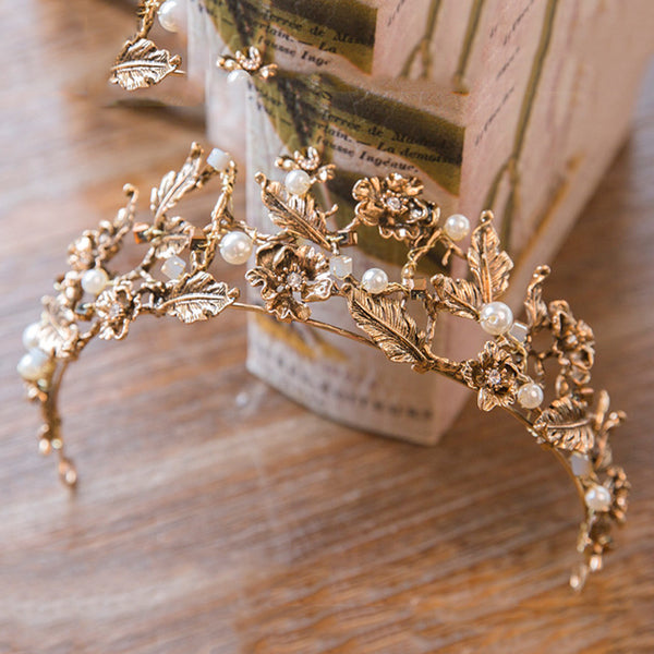 Gold tiara with flower design and pearls