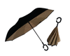 Inverted black and tan umbrella