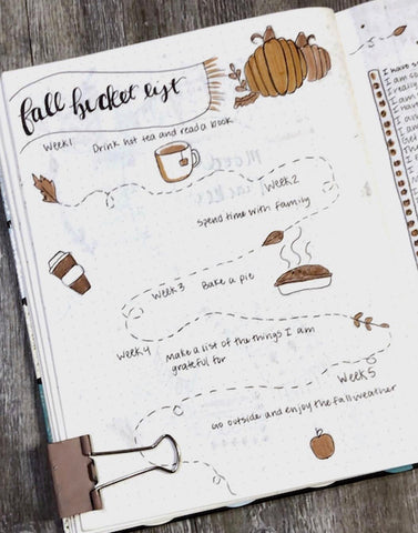 15 Fall Bullet Journal Ideas- Make your bujo beautiful this fall with inspiration from these 15 fall bullet journals! There are so many beautiful autumn-themed weekly spreads, trackers, and more to try! | autumn bullet journal pages, fall planner ideas, #bulletJournal #bujo #bulletJournalLayout #planner #DigitalDownloadShop