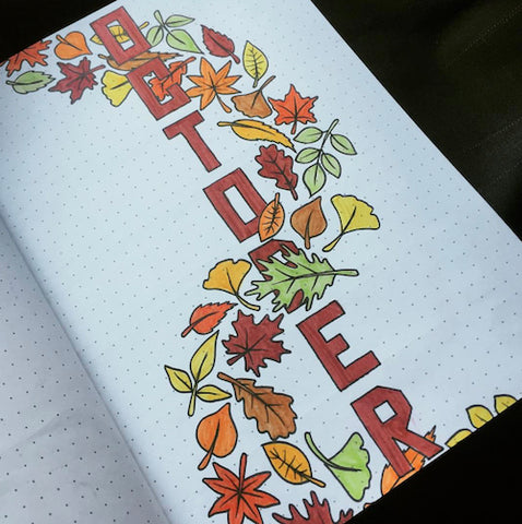 Fall Bullet Journal Cover- Make your bujo beautiful this fall with inspiration from these 15 fall bullet journals! There are so many beautiful autumn-themed weekly spreads, trackers, and more to try! | autumn bullet journal pages, fall planner ideas, #bulletJournal #bujo #bulletJournalLayout #planner #DigitalDownloadShop
