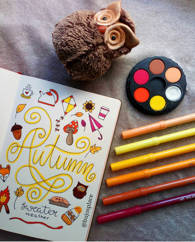 Autumn Bullet Journal Cover- Make your bujo beautiful this fall with inspiration from these 15 fall bullet journals! There are so many beautiful autumn-themed weekly spreads, trackers, and more to try! | autumn bullet journal pages, fall planner ideas, #bulletJournal #bujo #bulletJournalLayout #planner #DigitalDownloadShop