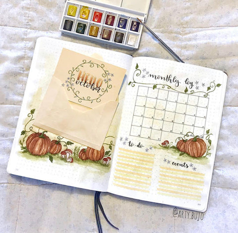 Pumpkin Bullet Journal Spread- Make your bujo beautiful this fall with inspiration from these 15 fall bullet journals! There are so many beautiful autumn-themed weekly spreads, trackers, and more to try! | autumn bullet journal pages, fall planner ideas, #bulletJournal #bujo #bulletJournalLayout #planner #DigitalDownloadShop