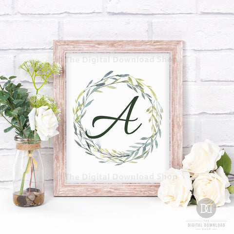 Watercolor Greenery Monogram Wall Art Free Printable- Add a personal touch to your home's decor with this monogram wall art free printable with watercolor greenery! This would look gorgeous in any room of your home! | #freePrintable #freePrintables #wallArt #monogramWallArt #DigitalDownloadShop