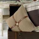 Square Taupe Pillow with Brown Leather Cross and Tan Button