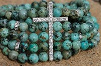 Turquoise stone beads with crystal cross